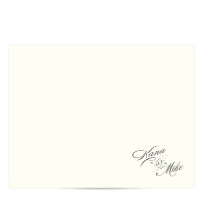 ivory flat card with charcoal grey cursive script in the bottom right hand corner